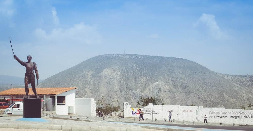 Mitad del Mundo hills with letters