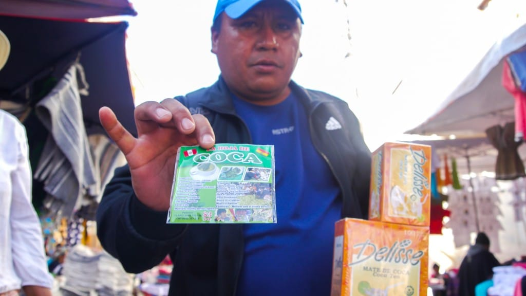 Otavalo man selling coca candy